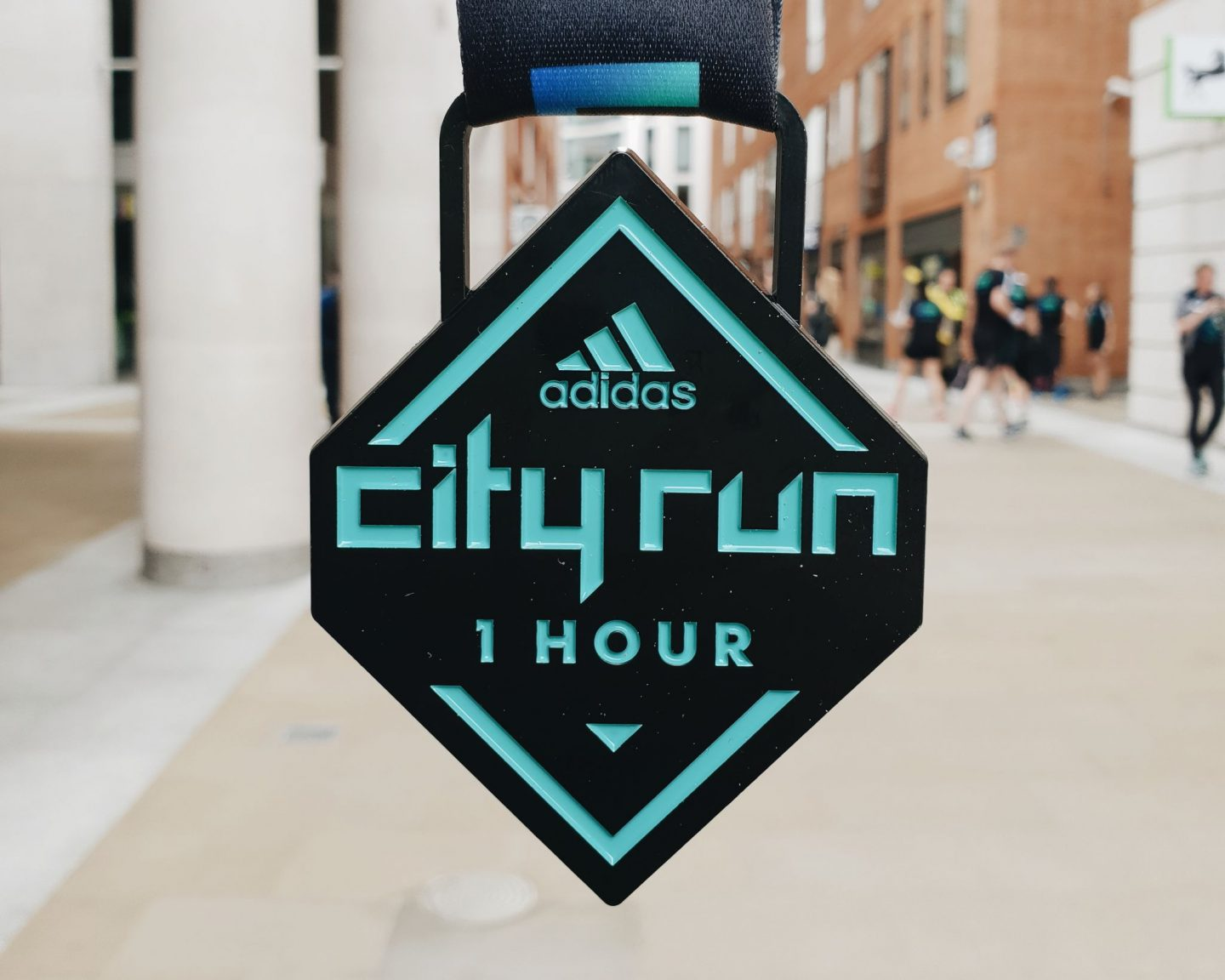 city run one hour medal close up