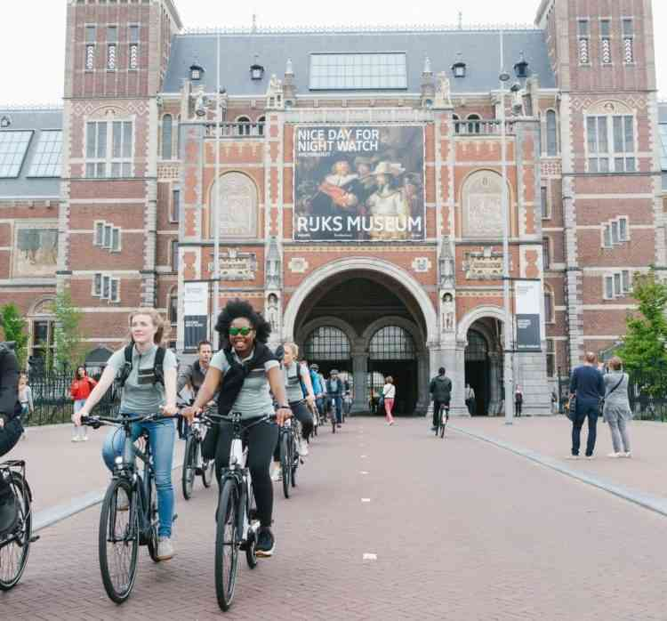cycling through rijksmuseum in amsterdam