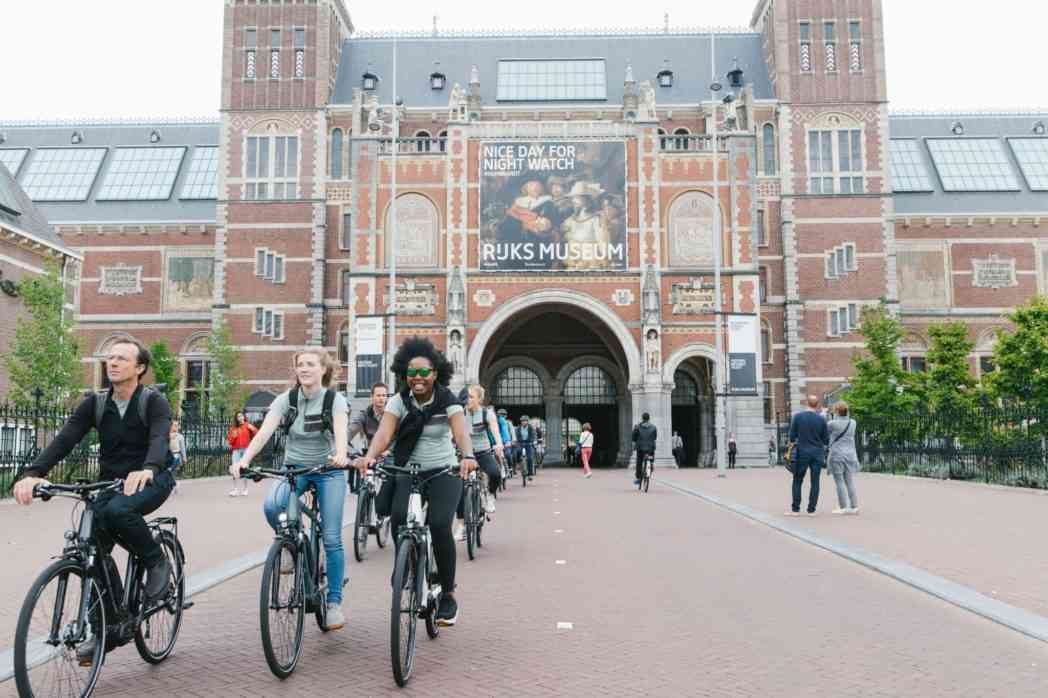 cycling through rijksmuseum in amsterdam