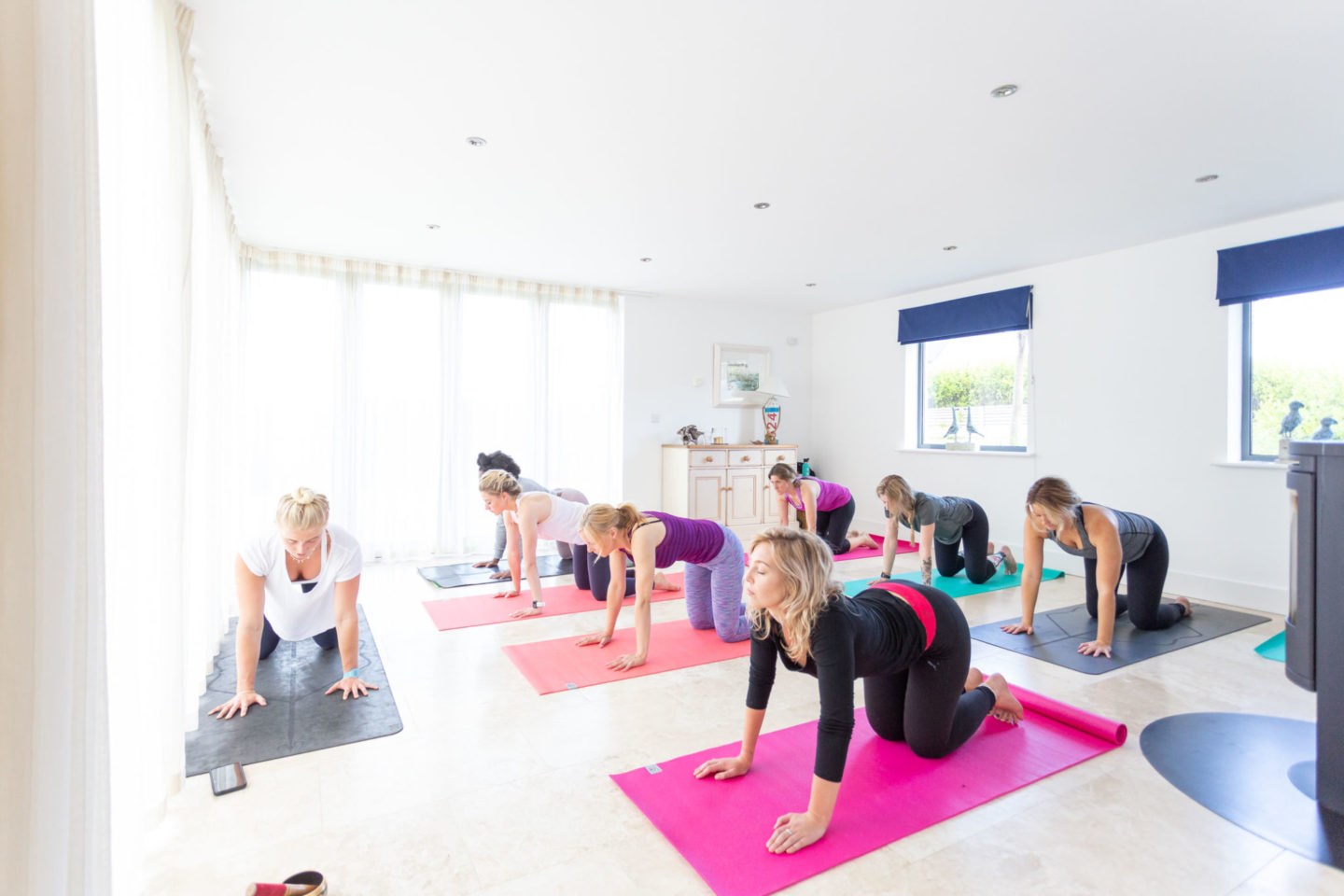 Participants in a home yoga class - Choosing Insurance For Your Fitness Classes