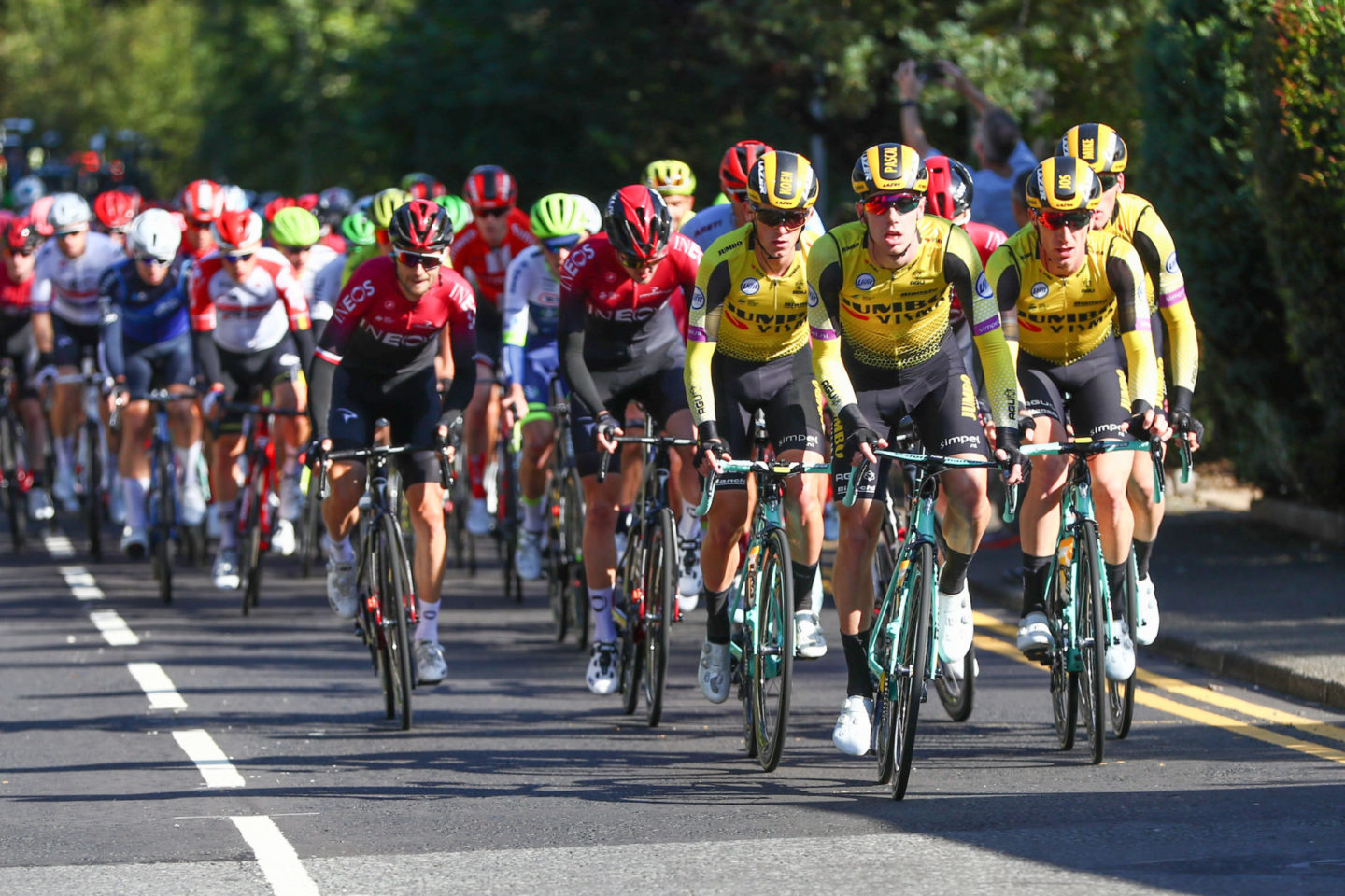 How Do I Make My Bike Go Faster | OVO Energy Tour of Britain 2019 | Expert Advice To Improve Your Cycling Training | Picture by SWpix.com - 07/09/2019 - Sport - Cycling - OVO Energy Tour of Britain 2019 - Stage 1: Glasgow to Kirkcudbright, Scotland - The peloton rolls through the suburbs of Glasgow, Jumbo Visma.