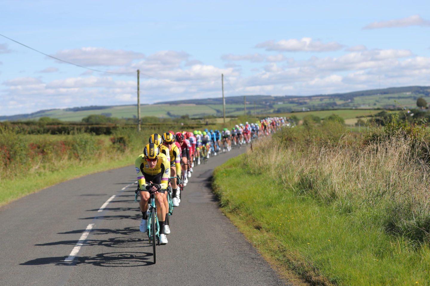 Picture by SWpix.com - 07/09/2019 - Sport - Cycling - OVO Energy Tour of Britain 2019 - Stage 1: Glasgow to Kirkcudbright, Scotland - Team Jumbo Visma on the front of the peloton.