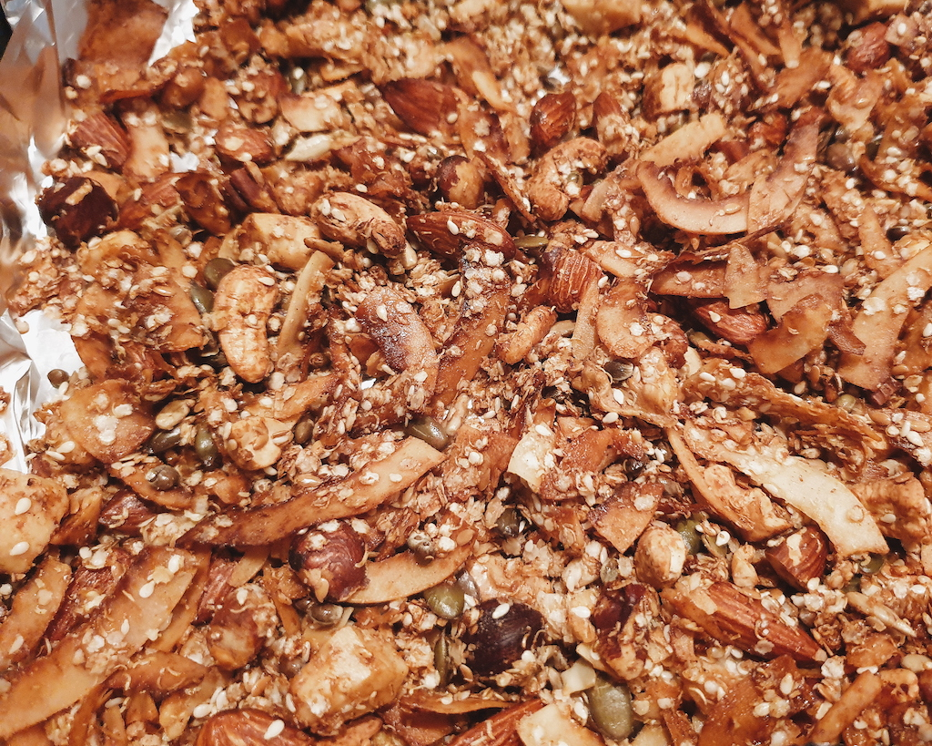 Grain Free Coconut Granola Recipe laid out on a baking tray after baking