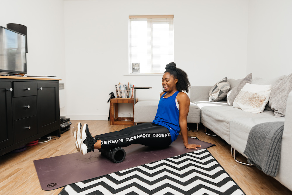 Elle foam rolling her calves to Improve Recovery & Performance