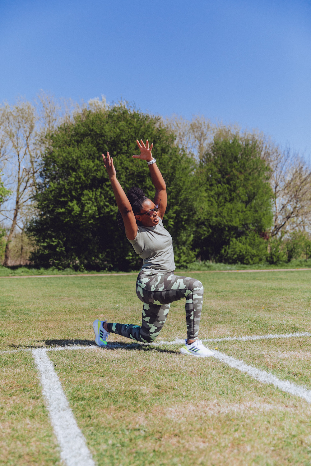 running warm up lunge with side reach in lululemon running leggings - Get Strong To Avoid Running Injuries
